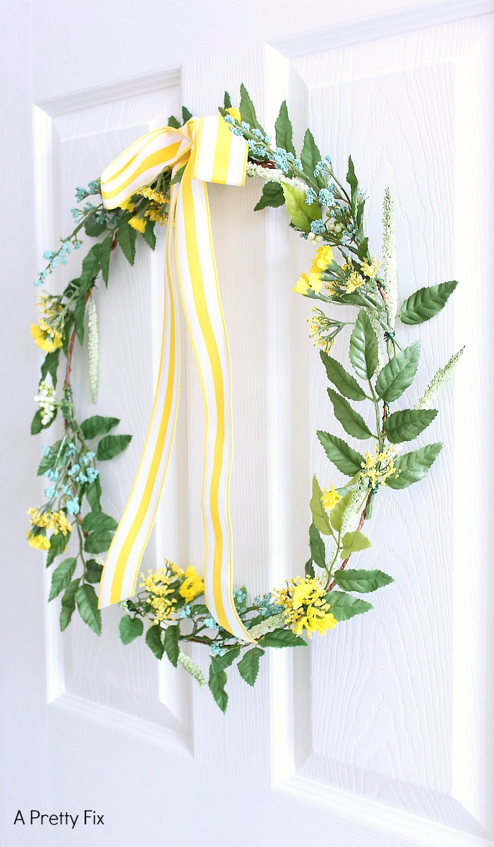 Making a pretty (faux) wildflower wreath is a lovely way to bring the outdoors in. In this step by step tutorial, learn how to make your own wildflower wreath for your home, wedding or special event.