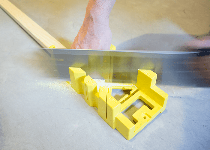 How To Frame a Canvas - Angled cuts using a miter box and hand saw.
