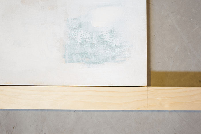 How To Frame Canvas Art - mark points to cut along wood pieces