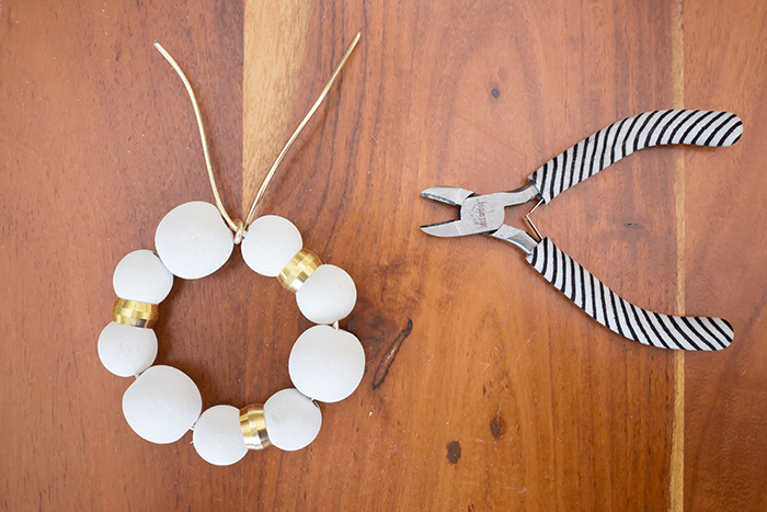 DIY Wood Bead Christmas Ornaments - twist wire ends together.