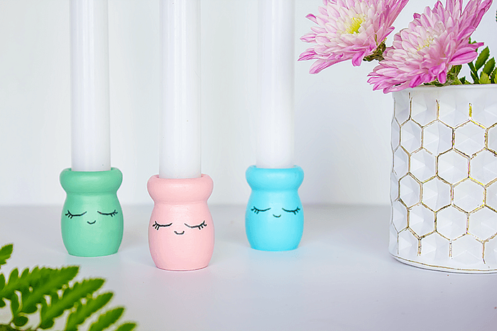 Add a little whimsy to your candle holders by applying some paint and a sweet 'shy face' outline. So much fun and so easy to do. A wonderful craft project to do with the kiddos!