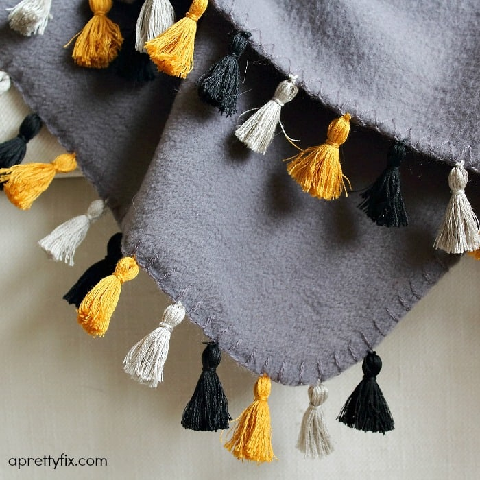 Transform a basic fleece throw by adding this chic and simple DIY mini tassel fringe detail.