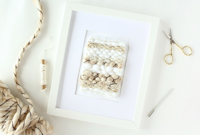 Create your own DIY mini framed weaving in an hour using a loom, yarn scraps and basic frame. A unique idea to add to a gallery wall or hang on its own to add a warm touch to any room.