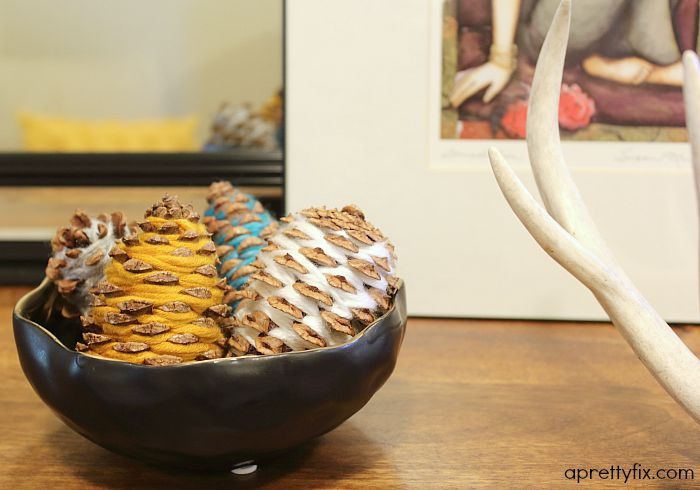 These modern, yarn-wrapped pinecones are a great way to inject some colour into your fall decor this year. A fun and easy project to share with the kids.