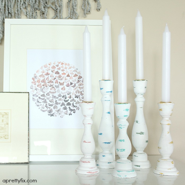 These colourfully-distressed candlesticks are a modern take on the 'shabby chic' look. An easy way to freshen up your home.
