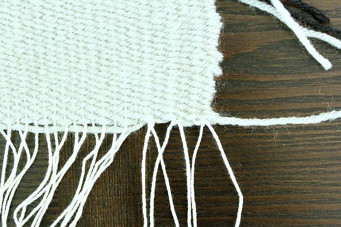 DIY Woven Pillow - tie warp strands.