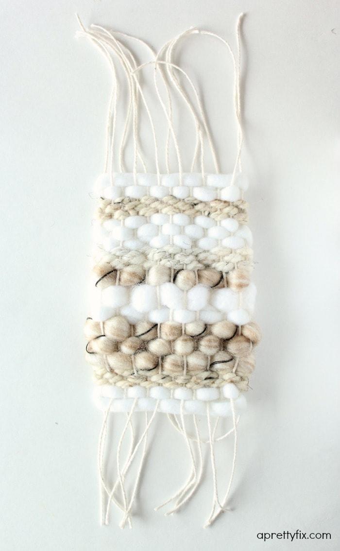 DIY mini framed weaving - snipped warp strands.