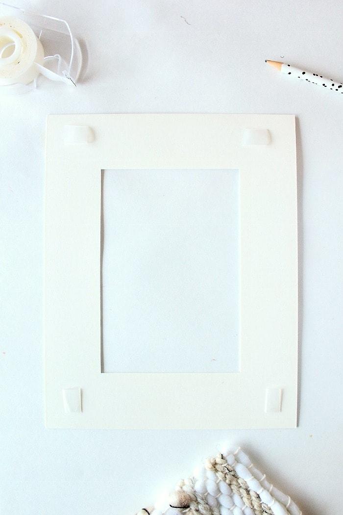 DIY mini framed weaving - tape back of frame mat.