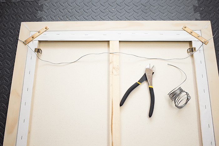 How To Frame Canvas Art - cut length of wire.