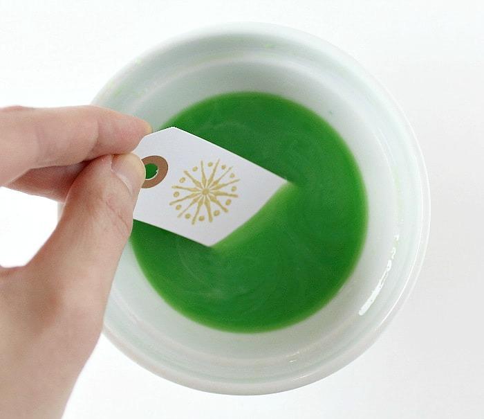 Dip gift tag in juice.