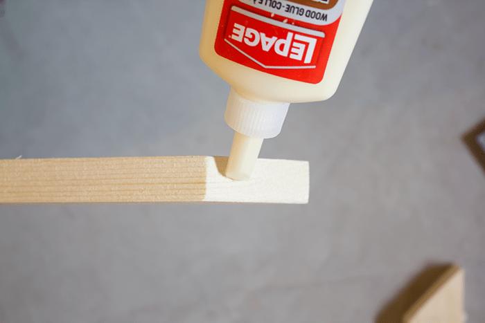 How To Frame a Canvas - glue corners.