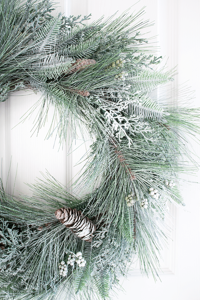 Giving a wreath or any synthetic greenery that 'snowed' effect is incredibly easy (no flocking required). Get the look in just minutes!