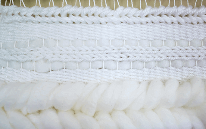 Weaving Techniques/Adding Texture: Soumak finish along top edge.