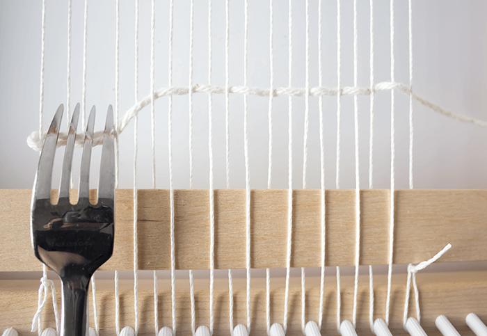 Push row of weaving with fork - 3 mini weavings.