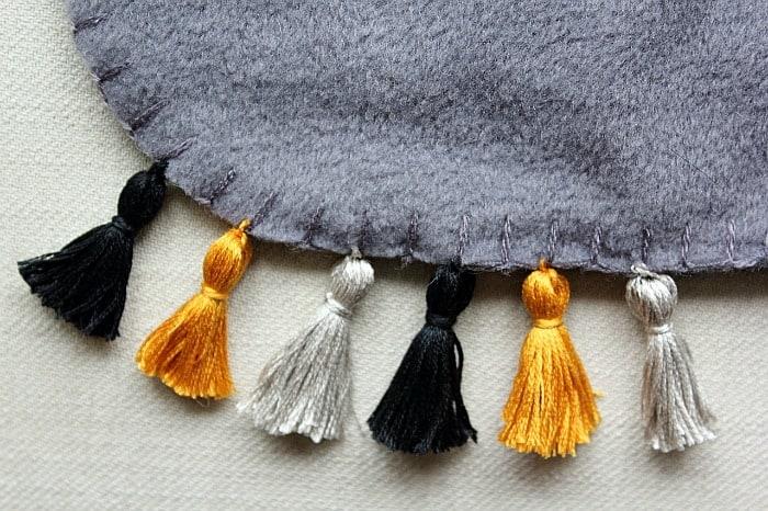 attach tassels to throw