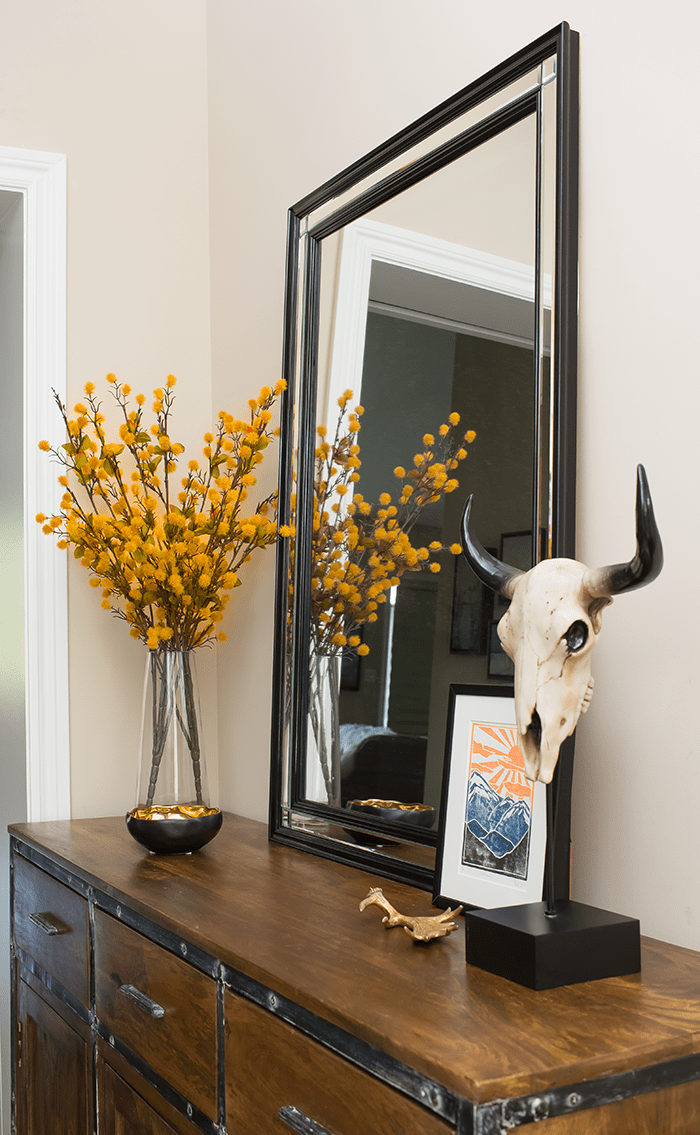 Get inspired for fall with this bold and modern rustic foyer. Plenty of ideas and styling tips for anyone looking for a contemporary twist on fall.