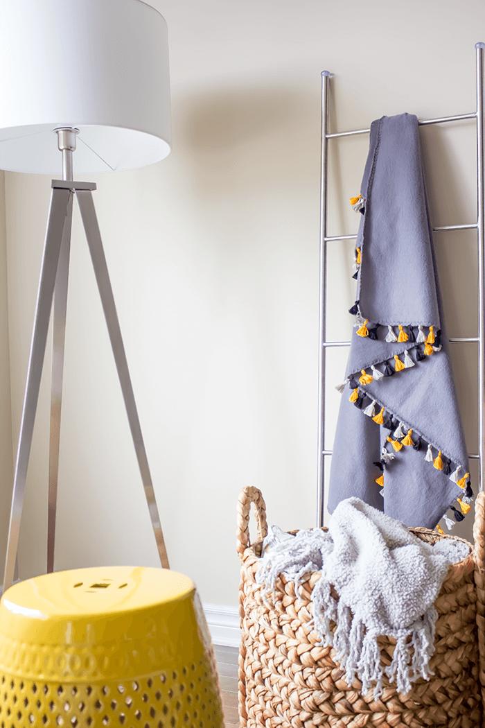 Ladder Display - Fringe Throw // 8 Wall Decor Ideas.