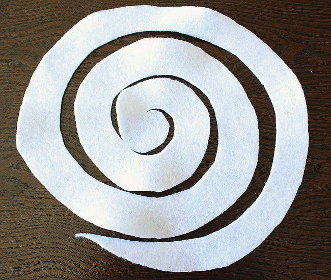 DIY yarn/felt wreath - first floret spiral cut.