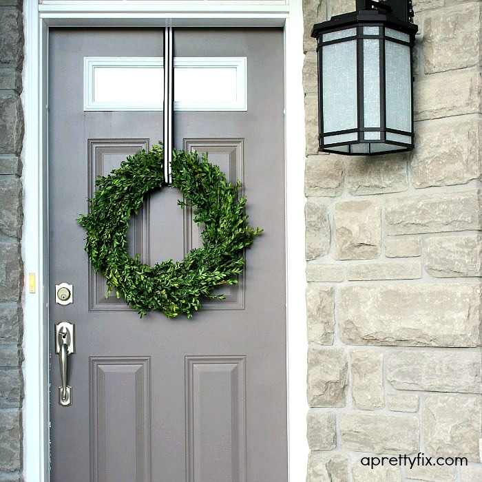 No glue or floral wire is required to make this chic and modern boxwood wreath.